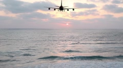 Passenger plane flies over the sea at night. Stock Footage