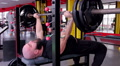 Strong athlete doing bench press exercise, muscular bodybuilder training in gym Footage
