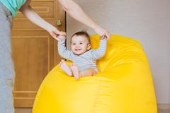 Beautiful expressive adorable happy cute laughing smiling baby infant face Stock Photos