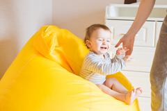 Beautiful expressive adorable happy cute laughing smiling baby infant face - stock photo