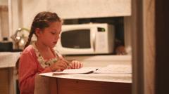 Little girl is doing her homework Stock Footage