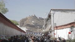 Tibet, Lhasa, May. A lot of people walking on the street in Tibet Stock Footage