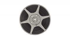 Spinning Vintage 8 mm Metal Film Reel Isolated on White - stock footage