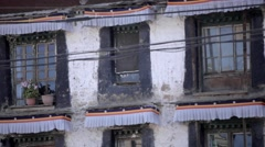 The white building with windows in Tibet. Tibetan architecture Stock Footage