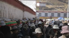 Tibet, Lhasa, A lot of people walking on the street in Tibet Stock Footage