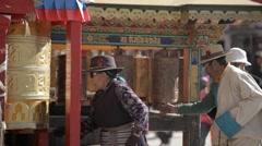 Tibet, LhasaTibetian prayer wheels of the faithful Buddhists Stock Footage