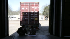 Driver gets papers stamped at warehouse Stock Footage