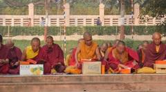 Monks praying,BodhGaya,Mahabodhi Temple Complex,India Stock Footage