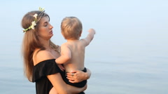 Mother in a black dress and a wreath, holding in the hands of his son on the Stock Footage