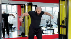 Self-confident successful sportsman with ideal body exercising at fitness club Stock Footage