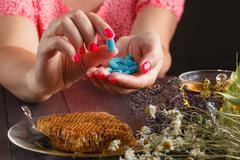 Healthcare and medicine: Young woman has control over pills Stock Photos