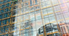 Modern architecture detail; glass wall with elevators Stock Footage