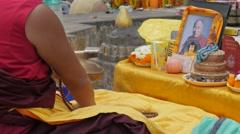 Tibetan monk praying with gems,BodhGaya,Mahabodhi Temple Complex,India Stock Footage