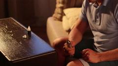 Man  filling tank of personal vaporiser for vaping Stock Footage
