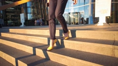 Slow motion. Young beautiful girl in a yellow shoes on hi heels coming down the - stock footage