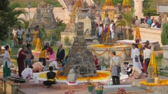 Pilgrims decorating structures with flowers,BodhGaya,Mahabodhi Temple,India Stock Footage