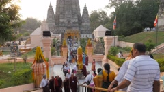 People walking to and from entrance,BodhGaya,Mahabodhi Temple Complex,India - stock footage