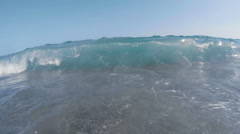 Clear blue sea waves breaking directly on the camera Stock Footage