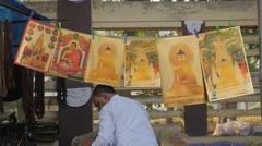 Buddhist religious souvenir seller,BodhGaya,India Stock Footage