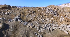 Aerial view of sand and rocks at the open pit quarry in East Port in the Russia Stock Footage