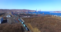 Aerial view of cargo cranes, coal, cargo railroad cars in East Port, Russia Stock Footage