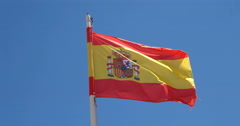 Closeup of Spanish flag flapping in the wind against blue sky Stock Footage