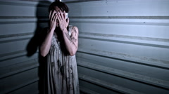 4k Horror Shot of a Dirty Zombie Woman Panicking  and Shaking  Stock Footage