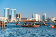Traditional arabic boats at Dubai creek, UAE Stock Photos