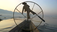 Fishermen in Inle Lake at sunrise, Shan State, Myanmar Stock Footage