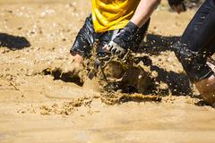 Extreme sport challenge muddy water Stock Photos