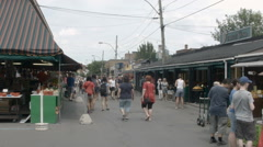 Jean-Talon market : Fixed shot of an exterior alley Stock Footage