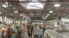 Jean-Talon market : Interior alley. People walks and shops groceries Stock Footage