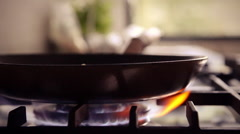 Gas stove wok burner ignited + baking pan utilized in modern design kitchen Stock Footage