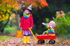 Kids trick or treating at Halloween Stock Photos