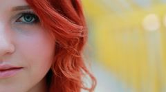 Portrait of a girl with red hair, interesting look, close up, young skin. - stock footage