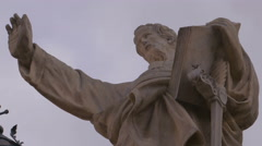 A low angle shot of a Statue of Saint Paul with his arm raised Stock Footage