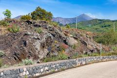 Mountain road to top of Etna volcano at Sicily, Italy Stock Photos