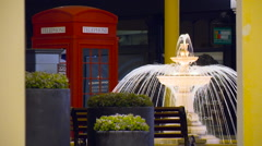 Fountain and Red Telephone Booth in the English Style. Moscow Shopping Center Stock Footage