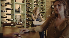 Young adult female waiting for someone at wine bar Stock Footage