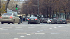 View of Cars go on the Road in the City, People Are Standing at a Traffic Light Stock Footage
