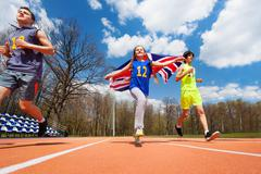 Team of three teenage sprinters with British flag Stock Photos