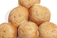 Close Up of Sesame Seed Covered Golden Bread Rolls - stock photo