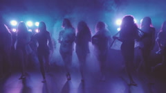 Shilouettes of female dancers group sensually walking  Stock Footage