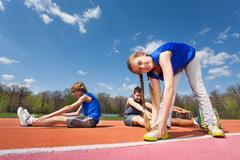 Gymnastic activity outside on the stadium - stock photo