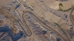 Industrial trucks moves along the road in the sand quarry Stock Footage