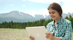 Tablet computer woman hiking in Grand Canyon using travel app or map during her Stock Footage