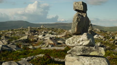 Cairns in rocky mountain landscape Stock Footage