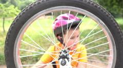 Boy spinning Bicycle wheel Stock Footage