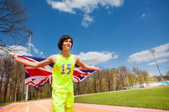 Teenage sprinter waving the flag of Great Britain Stock Photos