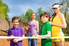 Happy sportive family with tennis apparel Stock Photos